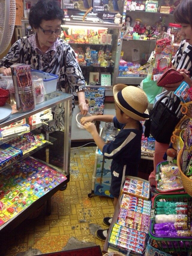 a boy enjoying the lot for candy