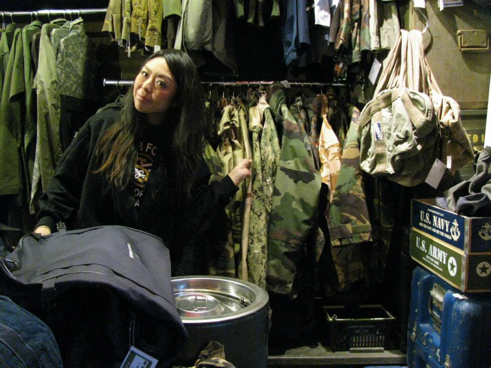 "Asami Enomoto,  a clerk of  ""D-GARAGE"", a military shop"