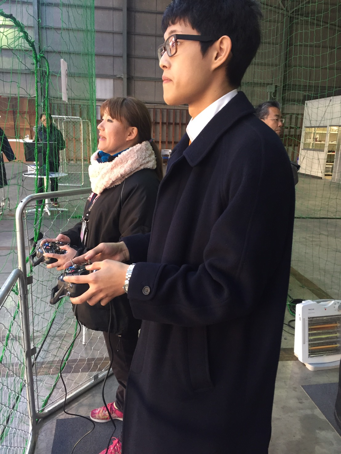 receiving an introduction on how to operate a drone from the instructor at the Tokyo branch of Drone School Japan